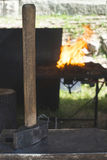 Blacksmith forges iron on anvil Stock Photography