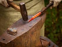 Blacksmith forges iron Stock Photo