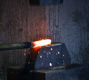 Blacksmith forges a red-hot iron Stock Image