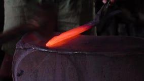Anvil in a blacksmith workshop. Blacksmith forges a red-hot iron in the forge. Anvil in the forge stock video footage