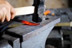 Blacksmith forges a spear Stock Photo