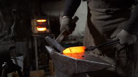 Blacksmith Forging Blade of Knife in Smithy
