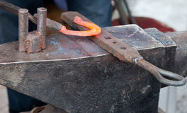 Blacksmith forging a horseshoe Royalty Free Stock Photo