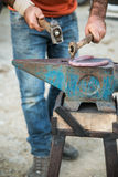Blacksmith forging a horseshoe Royalty Free Stock Photos