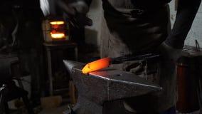 Blacksmith Forging Hot Iron in a Smithy