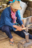 Blacksmith forging an iron piece on the anvil Royalty Free Stock Image