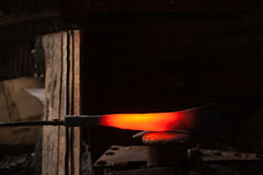 Blacksmith forging a knife Stock Image