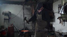 Blacksmith Forging Molten Metal in Smithy