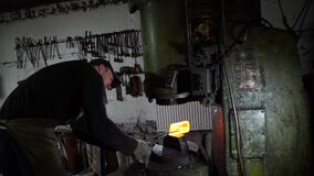 Blacksmith Forging Red Hot Iron Under Huge Press