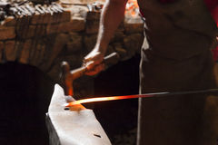 Blacksmith forging steel. With hammer and anvil (blurred hammering for sense of motion Stock Photos