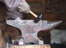 Blacksmith With Hammer And Anvil Royalty Free Stock Photo