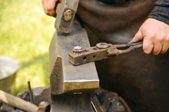 Blacksmith hammering hot steel Royalty Free Stock Photos