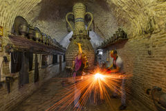 Blacksmith hammering the iron. Royalty Free Stock Photography