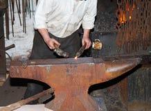 Blacksmith Hammering metal Royalty Free Stock Photo