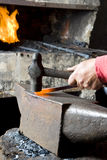 Blacksmith Hammering A Steel Stock Photography