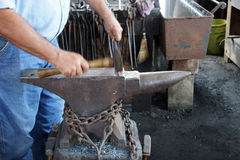 Blacksmith hammers nails Royalty Free Stock Images