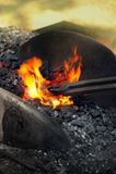 Blacksmith heating up iron Royalty Free Stock Images