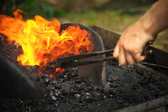 Blacksmith heating up iron Royalty Free Stock Photo