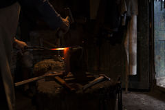 Blacksmith in his workshop forging Royalty Free Stock Images