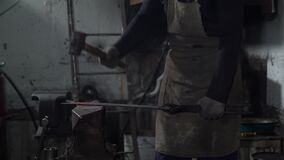 Blacksmith Hitting a Hot Red Metal with a Hummer