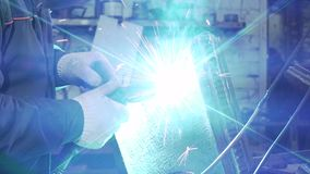 Blacksmith Holding Welding Machine For Welding Details