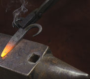 Blacksmith with hot iron Royalty Free Stock Photos