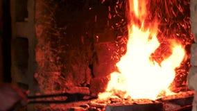 Blacksmith lightning fire in furnace. Blacksmith working at workshop. Blacksmithing concept stock footage