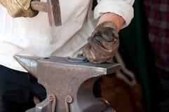 Blacksmith make a horseshoe Royalty Free Stock Photography