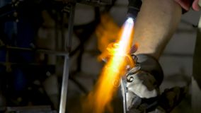 Blacksmith makes an iron rose. Man makes a rose out of iron Stock Photo