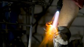 Blacksmith makes an iron rose. Man makes a rose out of iron Stock Image