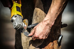 Blacksmith making horseshoes Stock Photo