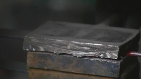 Blacksmith manufactures sheet metal plant. Hammer. Forge. Close-up. Hot metal. Iron. Sparks. Chisel. Hydraulic hammer stock video footage
