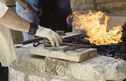 Blacksmith melting stock photo