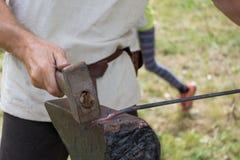 Blacksmith at metalworking stock photo