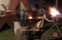Blacksmith minting metal table Royalty Free Stock Image