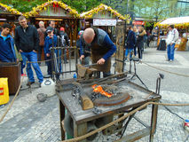 Blacksmith and an old blacksmith work at the Easter markets. Prague, Czech Republic, Stock Images