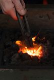 Blacksmith pliers in a hot furnace Stock Photography