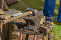 Blacksmith working place - hammers and the anvil royalty free stock image