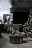 Blacksmith's Forge. The forge is used to heat up the metal before it is hammered into a shape using the anvil which is in the front of the picture Stock Images