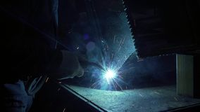 Blacksmith`s Hand In Protective Gloves Solder A Metal