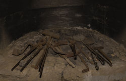 Blacksmith´s tools. In the hearth of an old smithery from the 19th century Royalty Free Stock Photo