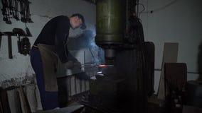 Blacksmith Shaping Hot Metal Using Forging Press