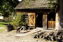Blacksmith Shop. Old historical blacksmith shop and his tools around it stock photos