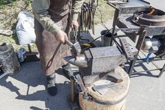 Blacksmith. shows how the process of manufacturing metal products. Forge industry iron anvil work hammer worker metalwork steel strength equipment occupation stock photography
