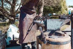 Blacksmith. shows how the process of manufacturing metal products. Forge industry iron anvil work hammer worker metalwork steel strength equipment occupation royalty free stock photography