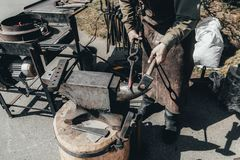 Blacksmith. shows how the process of manufacturing metal products. Forge industry iron anvil work hammer worker metalwork steel strength equipment occupation royalty free stock photo