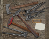 Blacksmith tools and business card over bench Stock Photography