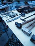 Blacksmith tools, on display above a work table, in a square in Rovereto for the holiday season royalty free stock photo