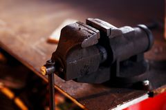 Blacksmith tools. Old vise in a forge shop Royalty Free Stock Photos