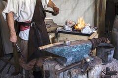 Blacksmith. Vitange way of making articles of iron Stock Image